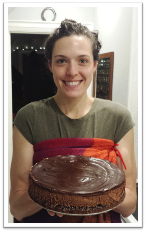 The author Julia holding her chocolate mousse cake