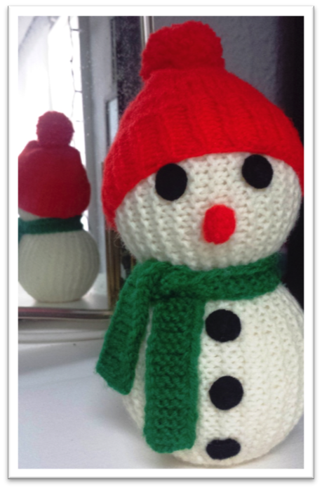 Picture of a small knitted snowperson